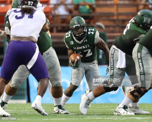Diocemy Saint Juste of the Hawaii Rainbow Warriors runs the ball in the first quarter of the game against the Western Carolina Catamounts at Aloha...