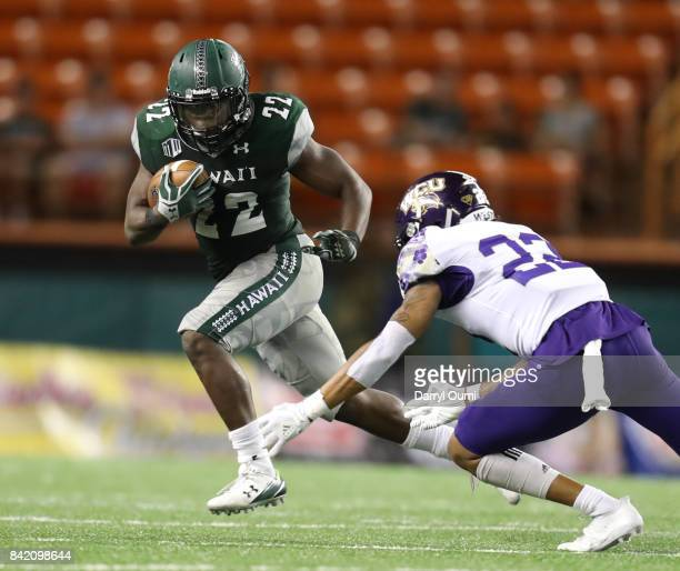 Diocemy Saint Juste of the Hawaii Rainbow Warriors tries to get around a defender in the third quarter of the game against the Western Carolina...