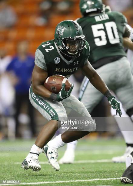 Diocemy Saint Juste of the Hawaii Rainbow Warriors waits for a hole to open during the fourth quarter of the game against the San Jose State Spartans...