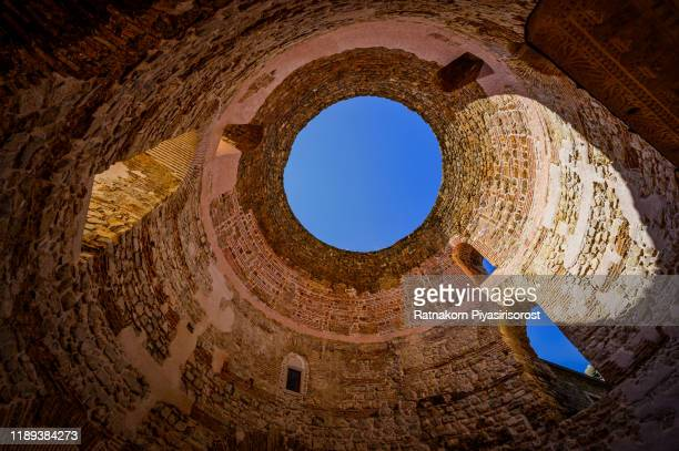 diocletian's palace's peristyle in front of cathedral of saint domnius' bell tower in split, croatia. diocletian palace unesco world heritage site in split, dalmatia, croatia - croatia stock pictures, royalty-free photos & images
