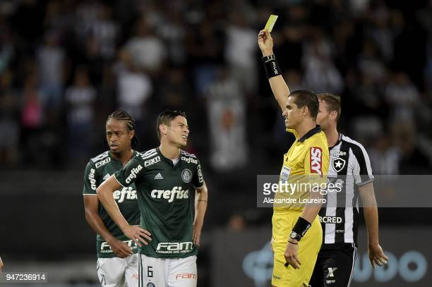 Diogo Barbosa of Palmeiras recevies a yellow card from referee Ricardo Marques Ribeiro during the match between Botafogo and Palmeiras as part of...
