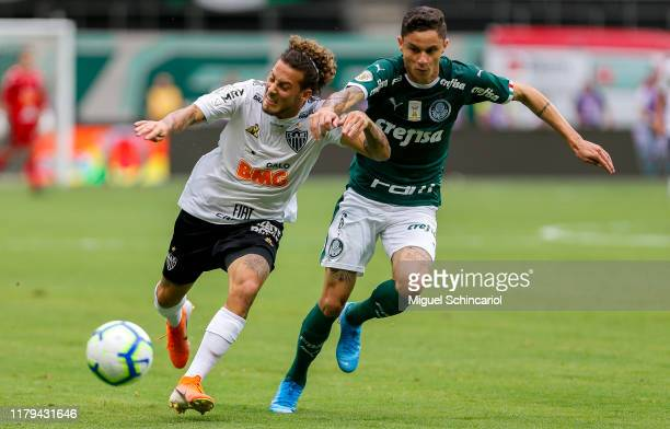 Diogo Barbosa of Palmeiras vies the ball with Guga of Atletico MG during a match between Palmeiras and Atletico MG for the Brasileirao Series A 2019...