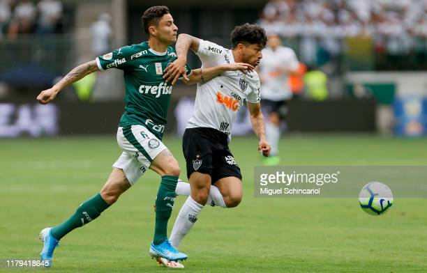 Diogo Barbosa of Palmeiras vies the ball with Luan of Atletico MG during a match between Palmeiras and Atletico MG for the Brasileirao Series A 2019...