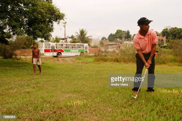 Diogo Brasil Lima a golf caddie in one of Rio de Janeiro's most exclusive clubs plays golf May 14 2003 at Japeri Municipal Public Golf Course in Rio...