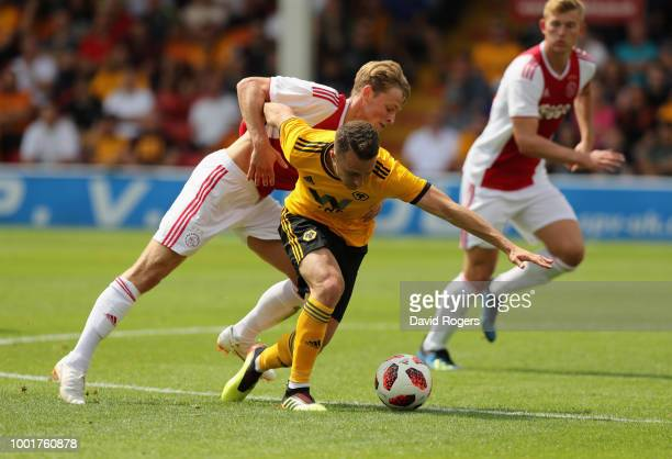 Diogo da Silva of Wolverhampton is tackled by Frenkie de Jong during the pre seaon friendly match between Wolverhampton Wanderers and Ajax at the...