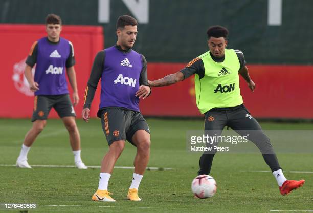Diogo Dalot and Jesse Lingard of Manchester United in action during a first team training session at Aon Training Complex on September 24 2020 in...