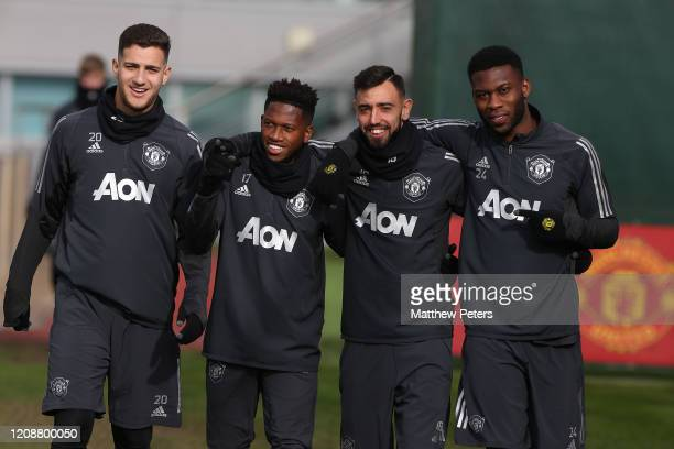 Diogo Dalot, Fred, Bruno Fernandes and Timothy Fosu-Mensah of Manchester United in action during a first team training session at Aon Training...