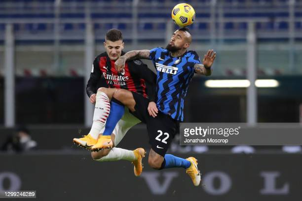 Diogo Dalot of AC Milan and Arturo Vidal of Internazionale contest for an aerial ball during the Coppa Italia match between FC Internazionale and AC...