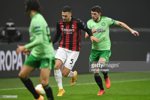 Diogo Dalot of AC Milan and Ryan Christie of FC Celtic Glasgow battle for the ball during the UEFA Europa League Group H stage match between AC Milan...