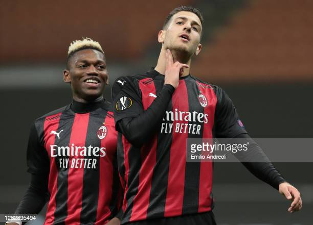 Diogo Dalot of AC Milan celebrates after scoring the second goal of his team with his team-mate Rafael Leao during the UEFA Europa League Group H...