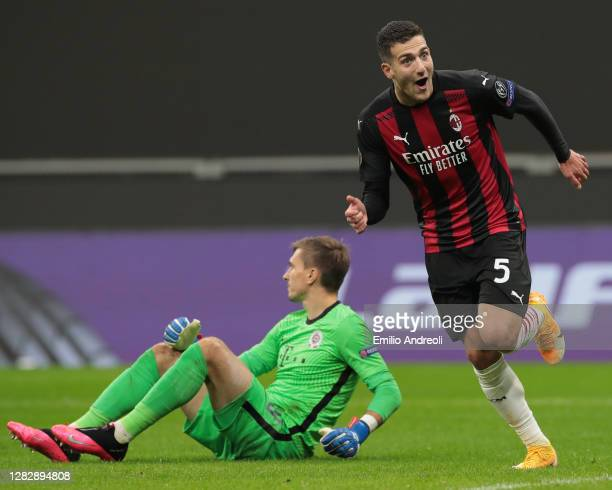 Diogo Dalot of AC Milan celebrates after scoring the third goal of his team during the UEFA Europa League Group H stage match between AC Milan and AC...