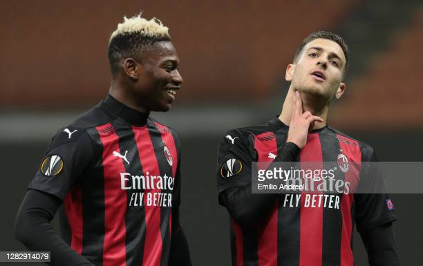Diogo Dalot of AC Milan celebrates his goal with his team-mate Rafael Leao during the UEFA Europa League Group H stage match between AC Milan and AC...