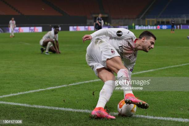 Diogo Dalot of AC Milan fails to keep the ball in play in what was the last kick of the game as the referee Jesus Gil Manzano of Spain decided to not...
