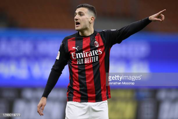 Diogo Dalot of AC Milan reacts during the Coppa Italia match between FC Internazionale and AC Milan at Stadio Giuseppe Meazza on January 26, 2021 in...