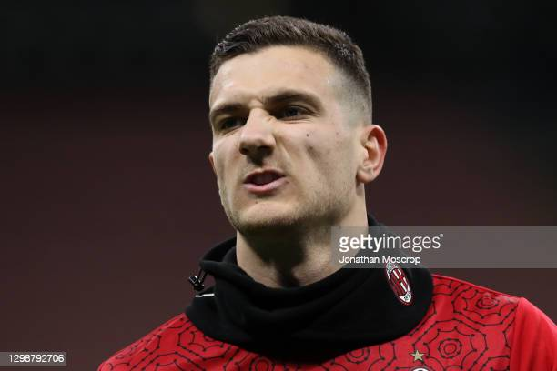 Diogo Dalot of AC Milan reacts during the warm up prior to the Coppa Italia match between FC Internazionale and AC Milan at Stadio Giuseppe Meazza on...