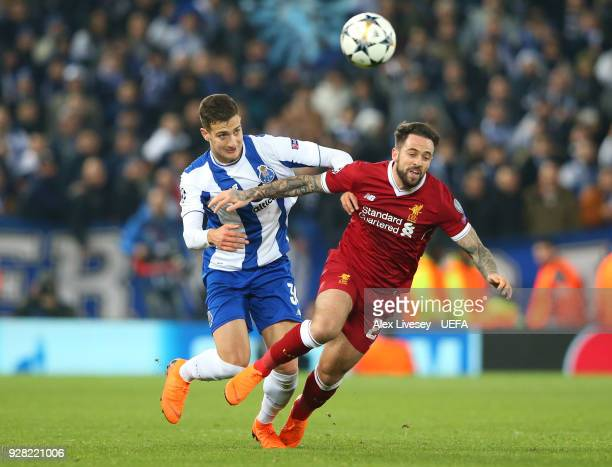 Diogo Dalot of FC Porto fouls Danny Ings of Liverpool during the UEFA Champions League Round of 16 Second Leg match between Liverpool and FC Porto at...