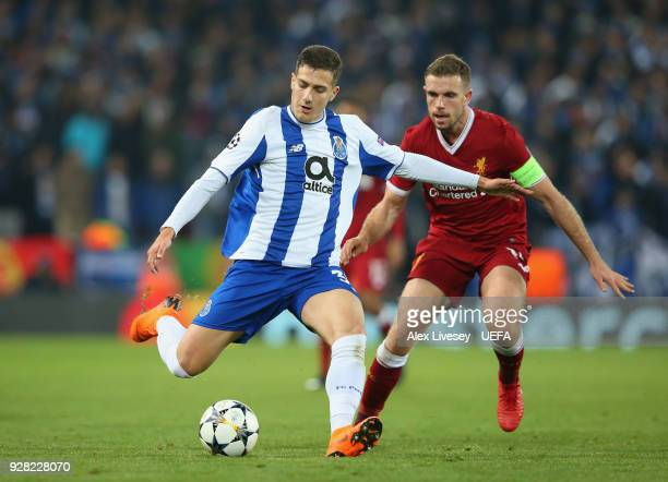 Diogo Dalot of FC Porto passes the ball ahead of Jordan Henderson of Liverpool during the UEFA Champions League Round of 16 Second Leg match between...