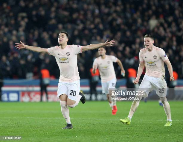 Diogo Dalot of Man Utd and Scott McTominay celebrate at the final whistle of the UEFA Champions League Round of 16 Second Leg match between Paris...