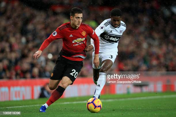 Diogo Dalot of Man Utd battles with Ryan Sessegnon of Fulham during the Premier League match between Manchester United and Fulham at Old Trafford on...