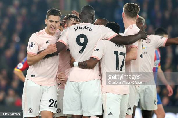 Diogo Dalot of Man Utd runs to congratulate Romelu Lukaku of Man Utd on scoring the opening goal during the Premier League match between Crystal...