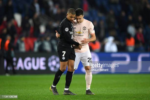 Diogo Dalot of Manchester United and Kylian Mbappe of PSG after the match during the UEFA Champions League Round of 16 Second Leg match between Paris...