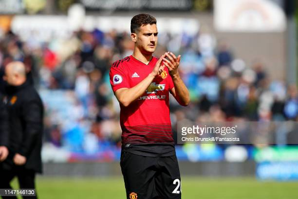 Diogo Dalot of Manchester United applauds the crowd after the Premier League match between Huddersfield Town and Manchester United at John Smith's...