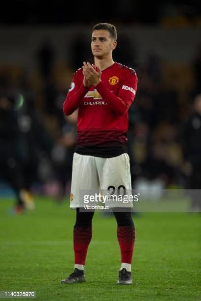 Diogo Dalot of Manchester United applauds the fans after the Premier League match between Wolverhampton Wanderers and Manchester United at Molineux...