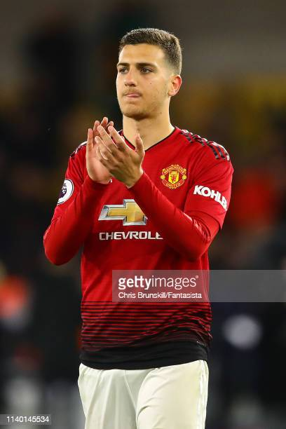 Diogo Dalot of Manchester United applauds the supporters following the Premier League match between Wolverhampton Wanderers and Manchester United at...