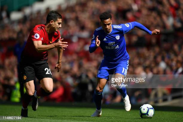 Diogo Dalot of Manchester United battles for possession with Josh Murphy of Cardiff City during the Premier League match between Manchester United...