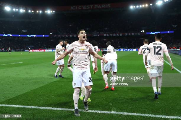 Diogo Dalot of Manchester United celebrates after Marcus Rashford scores his sides third goal during the UEFA Champions League Round of 16 Second Leg...