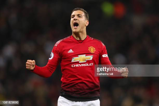 Diogo Dalot of Manchester United celebrates victory after the Premier League match between Tottenham Hotspur and Manchester United at Wembley Stadium...