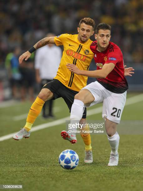 Diogo Dalot of Manchester United challenges Miralem Sulejmani of Berne during the Group H match of the UEFA Champions League between BSC Young Boys...