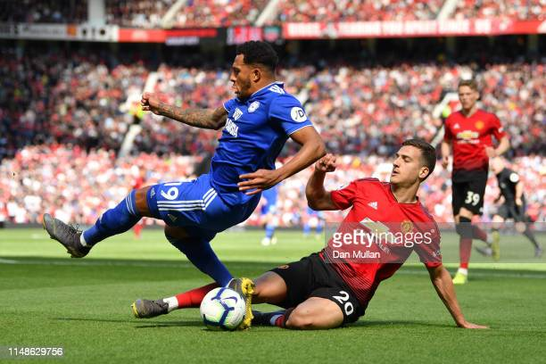 Diogo Dalot of Manchester United fouls Nathaniel MendezLaing of Cardiff City during the Premier League match between Manchester United and Cardiff...