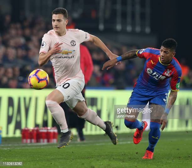 Diogo Dalot of Manchester United in action with Patrick van Aanholt of Crystal Palace during the Premier League match between Crystal Palace and...