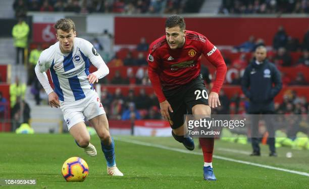 Diogo Dalot of Manchester United in action with Solomon March of Brighton Hove Albion during the Premier League match between Manchester United and...