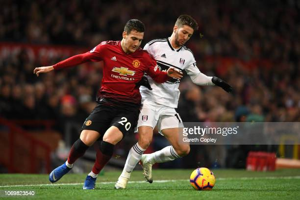 Diogo Dalot of Manchester United is challenged by Luciano Vietto of Fulham during the Premier League match between Manchester United and Fulham FC at...