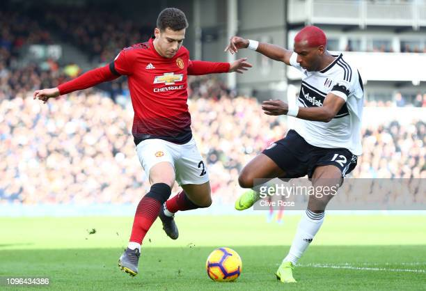 Diogo Dalot of Manchester United is challenged by Ryan Babel of Fulham during the Premier League match between Fulham FC and Manchester United at...