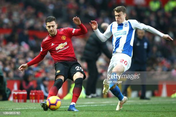 Diogo Dalot of Manchester United passes the ball under pressure from Solomon March of Brighton and Hove Albion during the Premier League match...