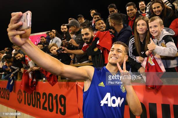 Diogo Dalot of Manchester United poses for a selfie with fans during a Manchester United training session at the WACA on July 11 2019 in Perth...