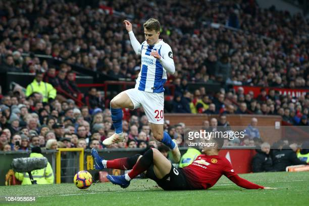 Diogo Dalot of Manchester United tackles Solomon March of Brighton and Hove Albion during the Premier League match between Manchester United and...
