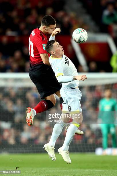 Diogo Dalot of Manchester United wins a header over Harry Wilson of Derby County during the Carabao Cup Third Round match between Manchester United...