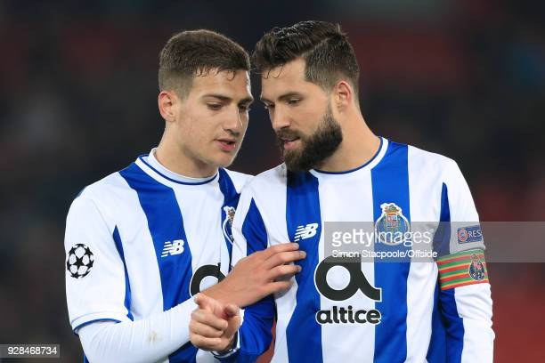 Diogo Dalot of Porto talks to teammate Felipe of Porto at the end of the UEFA Champions League Round of 16 Second Leg match between Liverpool and FC...
