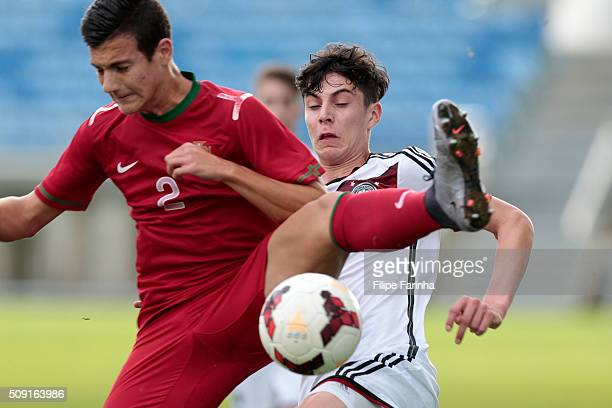 Diogo Dalot of Portugal challenges Kai Havertz of Germany during the UEFA Under17 match between U17 Portugal v U17 Germany on February 9 2016 in...