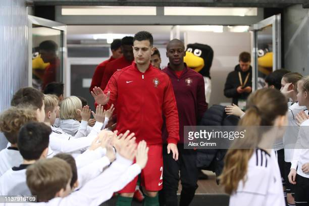 Diogo Dalot of Portugal walks out of the tunnel prior to the International friendly match between Germany U20 and Portugal U20 at BWTStadion am...