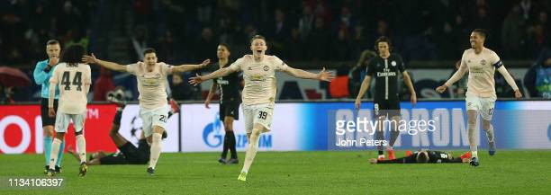 Diogo Dalot Scott McTominay and Chris Smalling of Manchester United celebrate at the final whistle during the UEFA Champions League Round of 16...