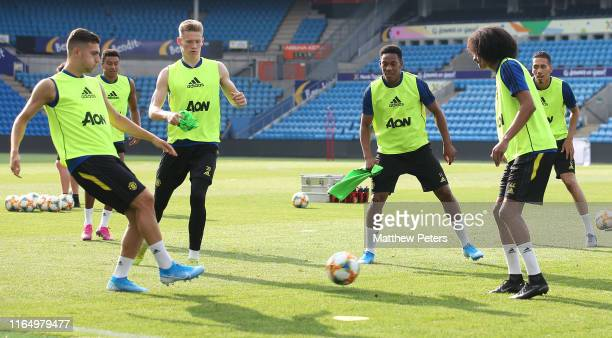 Diogo Dalot Scott McTominay Anthony Martial Tahith Chong of Manchester United in action during a first team training session ahead of their preseason...
