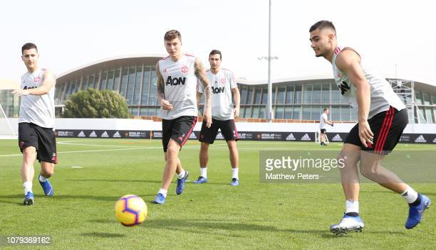 Diogo Dalot Victor Lindelof and Andreas Pereira of Manchester United in action during a first team training session at Nad Al Sheba Sports Complex on...