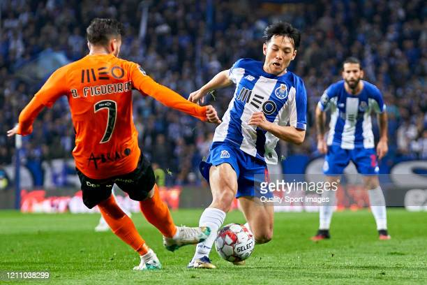 Diogo Figueiras of Rio Ave FC competes for the ball with Shoya Nakajima of FC Porto during the Liga Nos match between FC Porto and Rio Ave FC at...