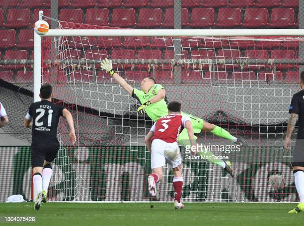 Diogo Gonçalves of Benfica scores their first goal from a free kick past Arsenal goalkeeper Bernd Leno during the UEFA Europa League Round of 32...
