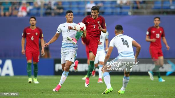 Diogo Goncalves of Portugal controls the ball under pressure from Jose Luis Rodriguez of Uruguay during the FIFA U20 World Cup Korea Republic 2017...
